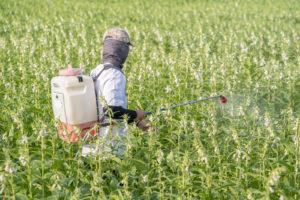 man spraying roundup - exposed to roundup weed killer causing cancer - dolman law group