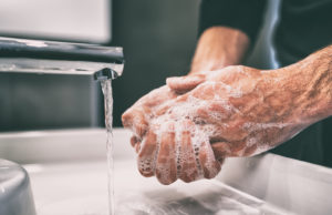 washing hands - COVID-19/ Understanding Commercial Insurance Policies That May Cover Your Business Loss and Interruption - Sibley Dolman Gipe Accident Injury Lawyers, PA