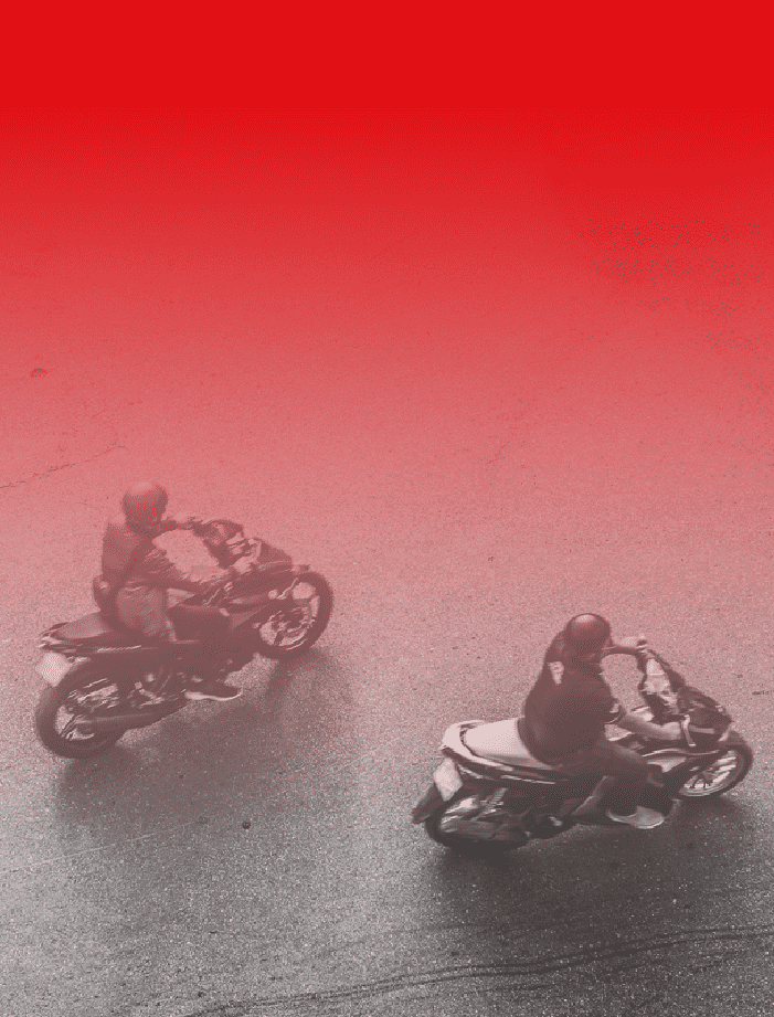 Two people riding motorcycles.